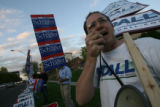 MJM103  Mark Udall supporter, Adam Axler (cq) shouts next to Bob Schaffer supporters compete for...