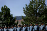 (PG10394) Over a hundred law enforcement officials pay their respects before a funeral service for...