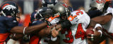 0015 Denver Broncos' (32) Dre Bly, and (58) Nate Webster wrap up Tampa Bay Buccaneers (34)Earnest...