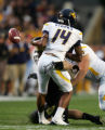 Brandon Nicolas causes Bradley Stark to fumble in the first quarter of Colorado against West...