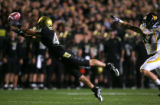 Cody Crawford can't quite catch a pass in the second quarter of Colorado against West Virginia at...