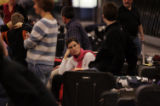 (Denver, Colo. - December 26, 2004) -- Sarah Chasnoff, of Cincinnati, wait for bags at Denver...