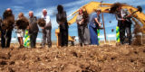 People use their shovels to dig during the groundbreaking ceremony for the Northwest Parkway, the...