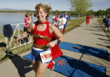DM0692  Dressed as Wonder Woman Shana Mader on the Justice League of America relay team smiles as...