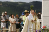 STANDALONE PHOTO - SENT TO AP -  Archbishop Charles Chaput blesses the 22-foot Sacred Heart of...