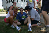 Relay runner Jon Parker (cq) collapses near the finish line of the 2008 Post News Colorado Colfax...