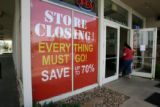 Signs at the door of Bova Furniture,  show the future of this store, Monday afternoon, May 19,...