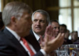 DM4060  Gov. Bill Ritter listens as Cathy Schull with Progressive 15 speaks during the annual...