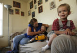 30 year-old Gena Meyer (cq) and her two kids, 5 year-old Toby Meyer (cq), (at right) who is...