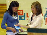 WEDNESDAY MAY 21ST, 2008 Manitou High School junior Mari Tanabe (left) gets a coveted Democratic...