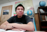 Emilio Lone Elk, listens to his Civics teacher at his school, Prarie High School R-11  west of...