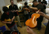 MJM153  Joel Noble's East High School shop class works on violins and drums Wednesday 05/07/08. ...