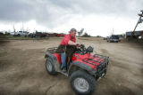 At Brown Cow Dairy, a rescued calf is carried on an ATV in Windsor, Colo. on Thursday May 22,...