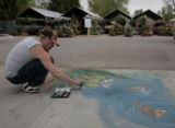 Robin Munro (cq) makes a mural on the sidewalk with chalk,  at the Denver Botanic Gardens, annual...