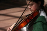 MJM672  Thomas Jefferson High School's Melissa Fife (cq), 16, plays her violin as she and others...