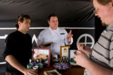 Chef Michael Long, right of Opus Restaurant and Dustin Reed, a food specialist for the Tazo Al...