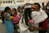 MJM250 Alex Rodriguez (cq),center right, hugs her grandfather, Pablo Rodriguez (cq) during her...