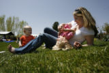 (from left) 1 year-old Hunter Hoid (cq) plays with her mother Jennifer Hoid (cq) and her older...