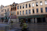 (Cheyenne, WYO. - 12 28, 2004) -- Firefighters roll up hoses on 16th Street in downtown Cheyenne...