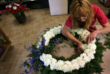 MJM282  The Petal'er Flowers and Gifts employee, Maria Trujillo (cq) prepare an arrangement Monday...