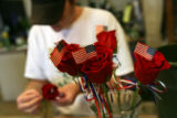 MJM182  Co-owner of The Petal'er Flowers and Gifts, Jenny Plane (cq) prepares arrangements Monday...