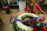 MJM332  The Petal'er Flowers and Gifts employee, Maria Trujillo (cq) prepare an arrangement Monday...