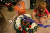 MJM383  Co-owner of The Petal'er Flowers and Gifts, Julie Mitchell (cq), left, watches as...