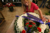 MJM368  The Petal'er Flowers and Gifts employee, Maria Trujillo (cq) prepare an arrangement Monday...