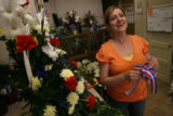 MJM458  Co-owner of The Petal'er Flowers and Gifts, Julie Mitchell (cq) prepares arrangements...