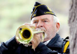 Corky Billings of the American Legion Post 32 in Longmont plays Taps at the cemetery near the end...