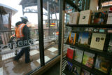 Workers continue work in the rain to get Borders ready for the opening at Park Meadows Mall in...