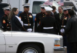 CODER102 Marines surround the family of Srgt. Glen Martinez, 31,Tuesday 05/13/08 before the...