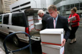 (PG5567)  Kristi Burton's brother, Josh, 17, and father, Mike unload signatures collected on a...
