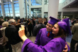 After South HS graduation, Ricardo Escobedo poses for a picture with Roksolana Fajda at the...