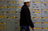 DM0889  Jim Goodrich with Excel Energy walks past a motor control box that once controlled aspects...