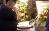 [Montbello, CO - Shot on: 1/12/05] Larry Green, 24, (LEFT) says goodbye to Contrell Townsend at...