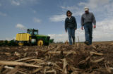 Dan and Peggy Brown, third generation Yuma County farmers checks a field where they planted corn...