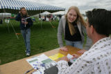 Emily Brien, 15, (cq) talks with Mike Lyons (cq) an elections operations manager at Chaparral High...