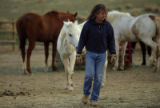 DM0559  Robin and Jay Davis tend to the horses at their equestrian center, Mustang Hollow, near...