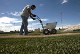 Efren Martinez (cq), lines the field, Friday morning, May 16, 2008, at Denver All City Stadium....