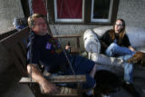 DM0134  Terry Smith enjoys a Sunday afternoon beer with his roommate/tenant Joe Pierce at his...
