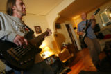 DM0362  Robert Guy, right, jams out with his tenant Joe Pierce during a recent visit to the house...