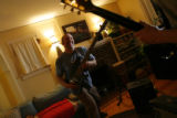 DM0677  Robert Guy, right, jams out with his tenant Joe Pierce during a recent visit to the house...