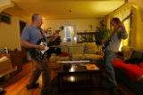 DM0537  Robert Guy, right, jams out with his tenant Joe Pierce during a recent visit to the house...