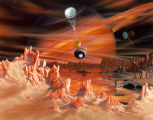 This artist's conception shows Titan's surface with Saturn appearing dimly in the background...