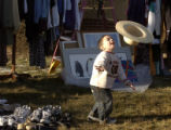 Lakewood,  Colorado-Jan. 7 2005.   Andrew Luna, 3 1/2, plays with a hat for sale at a garage sale...