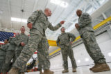 MJM078  Members of 2-238th General Support Aviation Battalion, Srgt. Nick Cornelius (cq), left...