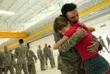 MJM247  Alicia Kreb (cq), 10, hugs her father, Srgt. Quince Kreb (cq) following a homecoming...