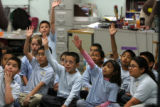 Third grade students answer a finance question in Siri Lewis's  class at Castro Elementary...