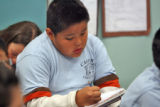 Stephen Enrico (cq) studies during third grade class taught by Mischa Bettis (cq)  at Castro...